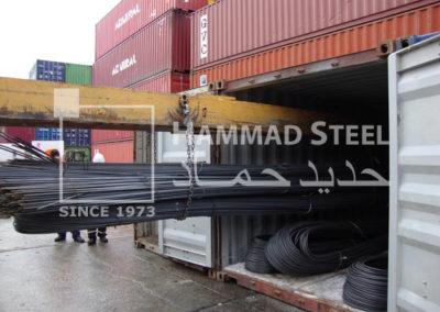 Heavey Crane Loading the Steel Rebars Bundles in Container