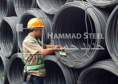 Inspector Checking the Quality of Steel Wire in Warehouse